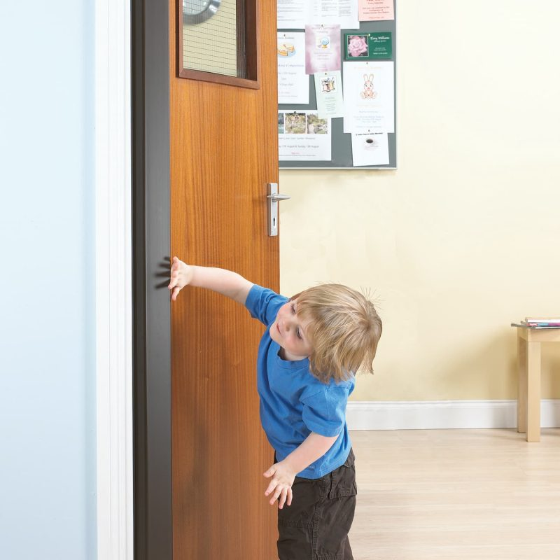 Child with fingers on door
